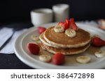pancakes with strawberries and... | Shutterstock . vector #386472898