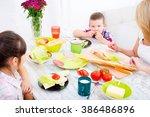 a mother and her children... | Shutterstock . vector #386486896
