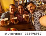 three young men in casual... | Shutterstock . vector #386496952