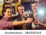 three young men in casual... | Shutterstock . vector #386500165