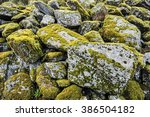 moss on pile of stone. | Shutterstock . vector #386504182