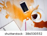on office desk  coffee spilled... | Shutterstock . vector #386530552