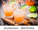 alcohol tequila sunrise... | Shutterstock . vector #386554366