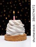 birthday cupcake with burning... | Shutterstock . vector #386574472