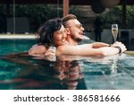 couple has a rest in the pool... | Shutterstock . vector #386581666
