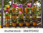 colorful flowers in wall flower ... | Shutterstock . vector #386593402