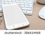 workplace with modern mobile... | Shutterstock . vector #386614468