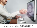 hand reaching out from screen ... | Shutterstock . vector #386648416