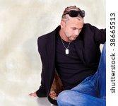 fashion shot of a young man... | Shutterstock . vector #38665513