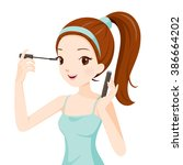 girl make up her eyes with... | Shutterstock .eps vector #386664202