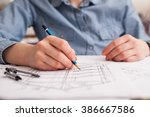 engineer at work with technical ... | Shutterstock . vector #386667586
