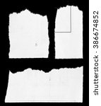 pieces of torn paper on black | Shutterstock . vector #386674852