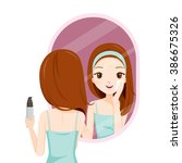 girl scrubbing her face and see ... | Shutterstock .eps vector #386675326