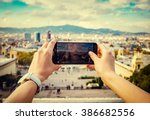 young woman taking a picture of ... | Shutterstock . vector #386682556