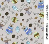 seamless pattern with a doodle...   Shutterstock .eps vector #386694538