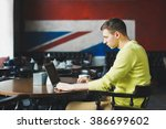 successful male programmer... | Shutterstock . vector #386699602