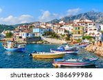 colorful fishing boats in... | Shutterstock . vector #386699986