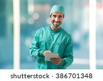 surgeon using a tablet | Shutterstock . vector #386701348