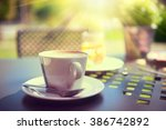 morning coffee on the terrace.... | Shutterstock . vector #386742892