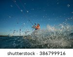 kite surf freestyle at sunset. | Shutterstock . vector #386799916