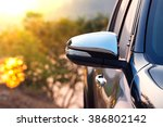 Black Car Side Mirror With Sun...