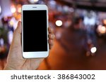 hand holding smartphone with... | Shutterstock . vector #386843002