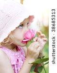 Little Girl Smelling A Pink Rose