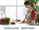 young woman preparing vegetable ... | Shutterstock . vector #386873662