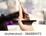 professional hairdresser... | Shutterstock . vector #386880472