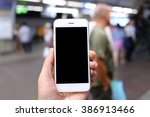 hand holding smartphone with... | Shutterstock . vector #386913466
