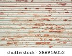 old and damaged metal shutters  | Shutterstock . vector #386916052
