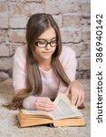 beautiful girl reading book.... | Shutterstock . vector #386940142