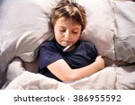 child sick in bed sleeping and... | Shutterstock . vector #386955592