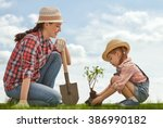mom and her child girl plant... | Shutterstock . vector #386990182