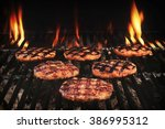 bbq grilled burgers patties on... | Shutterstock . vector #386995312