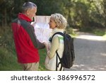 a mature couple walking in the... | Shutterstock . vector #386996572