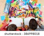 child drawing top view. artwork ... | Shutterstock . vector #386998018