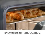 croissants in the oven - stock photo