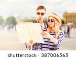 young couple of travelers... | Shutterstock . vector #387006565