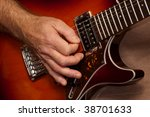 closeup of guitarists hand during a live performance - stock photo