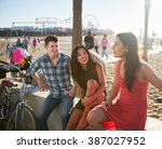 friends at santa monica beach... | Shutterstock . vector #387027952