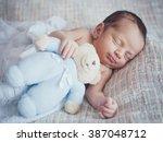 little newborn baby boy  | Shutterstock . vector #387048712
