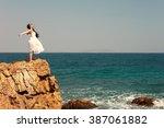 happy girl standing outdoor on...   Shutterstock . vector #387061882
