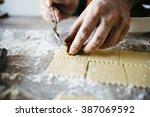 man making ravioli  italian... | Shutterstock . vector #387069592