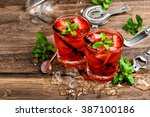red drink with ice  mint leaves ...