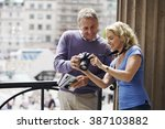 a middle aged couple standing... | Shutterstock . vector #387103882
