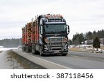 Small photo of SALO, FINLAND - MARCH 4, 2016: Volvo FH16 750 logging truck hauls pulp wood along highway. The new bioproduct mill of Metsa Group, currently under construction, is estimated to create 1500 new jobs.