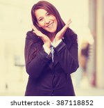 cool business woman smiling | Shutterstock . vector #387118852