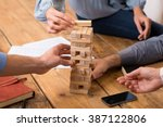 close up of hands helping build ... | Shutterstock . vector #387122806