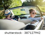 rear view. young trendy couple... | Shutterstock . vector #387127942
